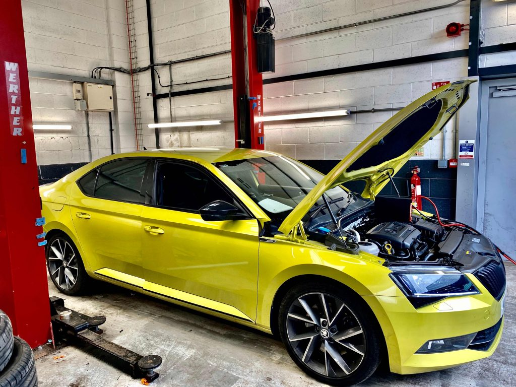 Lime green Skoda being mapped by South West DPF Cleaning