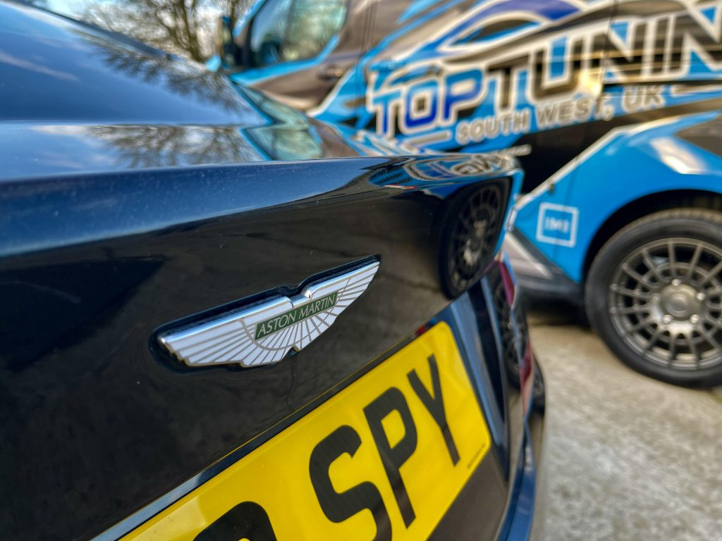 Close up of Aston Martin next to South West DPF Cleaning van